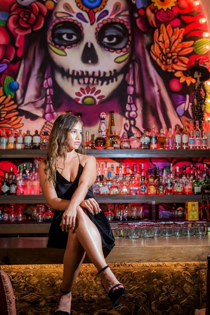 Girl Sitting on Bar