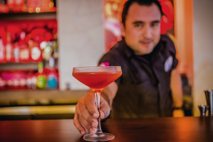 Bartender Serving a Hibiscus Margarita