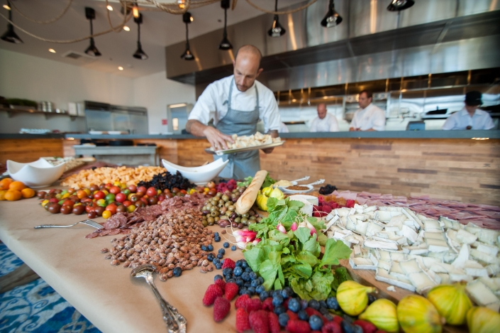 Chefs preparing a large spread for a private event