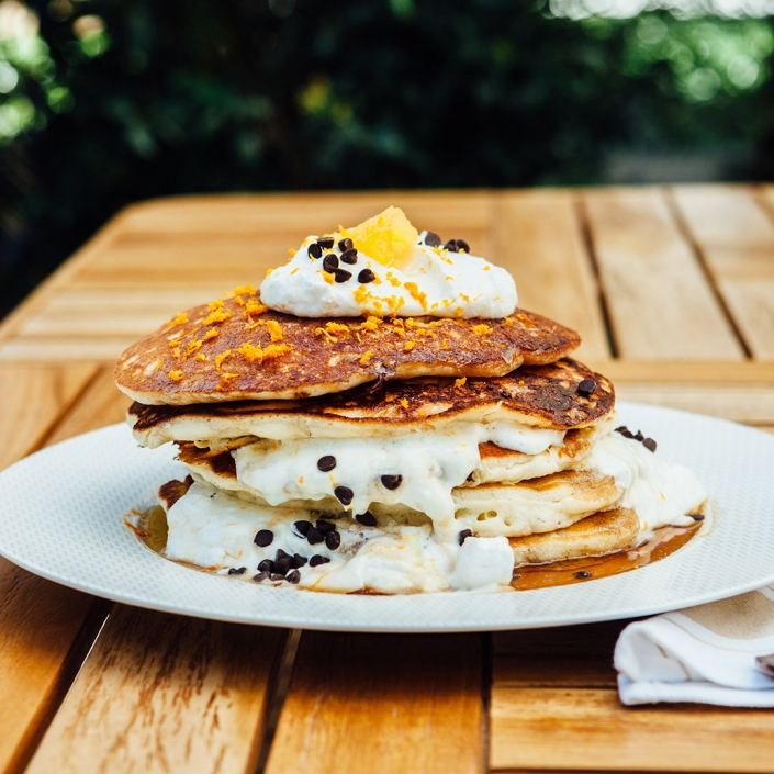 Pancakes with whipped cream and chocolate chips