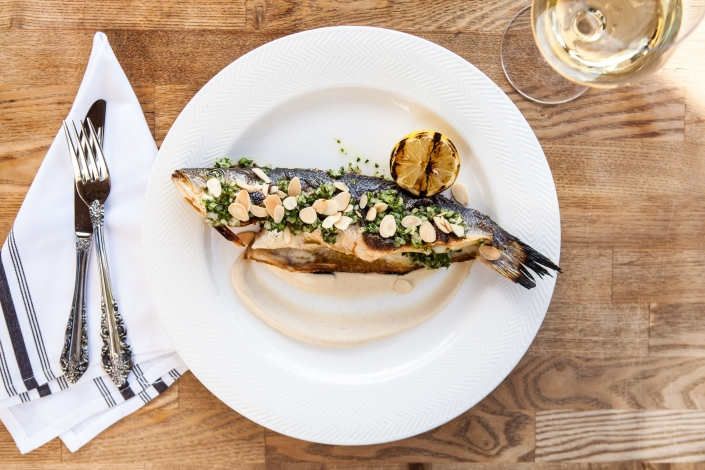 Whole roasted branzino with pesto and almonds