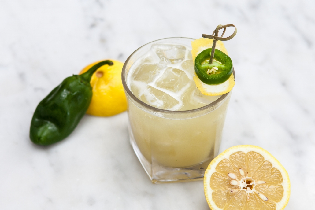 Yellow cocktail with jalapenos