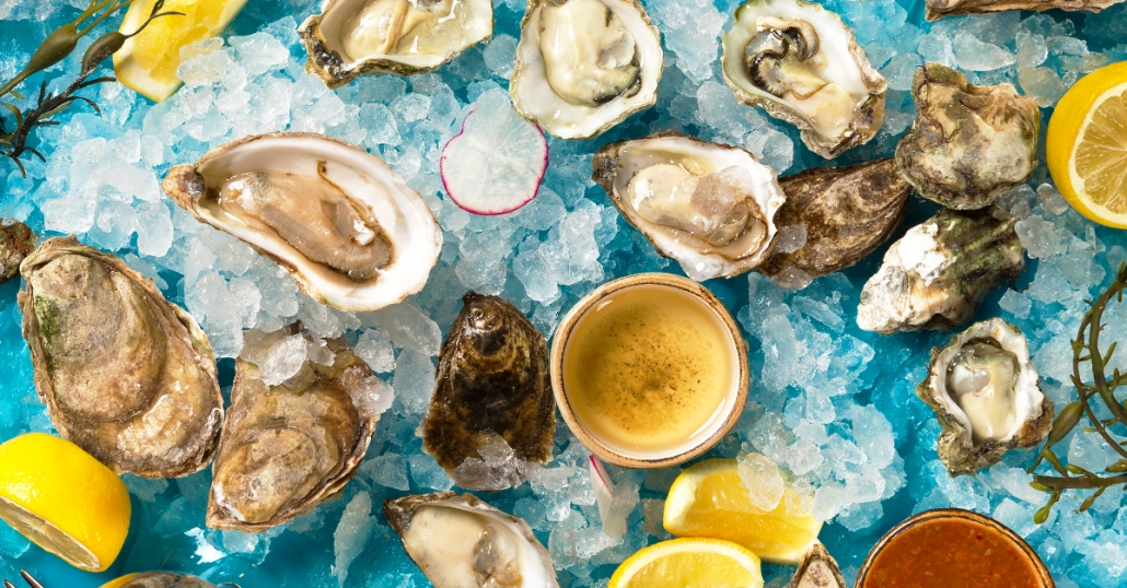 Oysters on ice with lemons