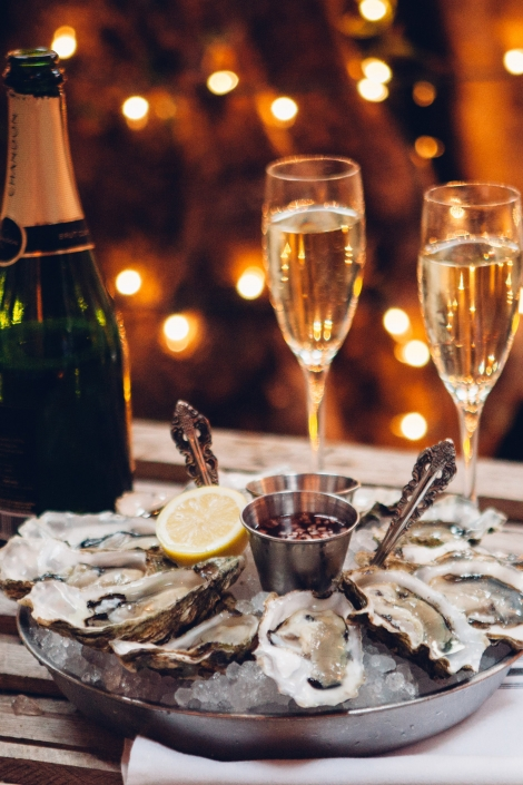 Oysters with Champagne and Flickering lights at Herringbone La Jolla