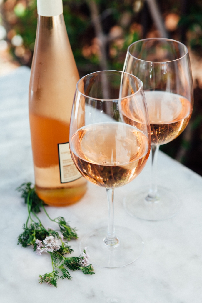 Two wine glasses with Rose and bottle of rose