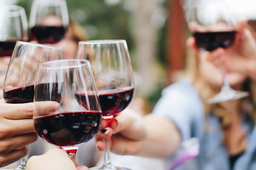 Cheering red wine glasses