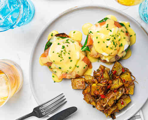 Eggs Benedict at Herringbone La Jolla's weekend brunch